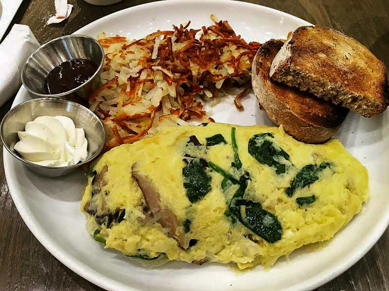 Shroomed Omelette,Cupitol - Perfectly cooked and flavorful, this omelette may be the fluffiest combination of gruyere, spinach, and mushrooms (and hash browns) you've ever tried.