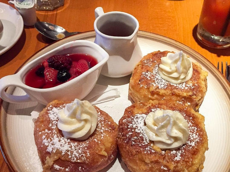 Donut French Toast, The Cellar - The verdict is out: donuts and french toast combine to make a very fluffy, moist, and sweet meal. To avoid overindulging, share with someone else and complement the sweetness with a savory dish.