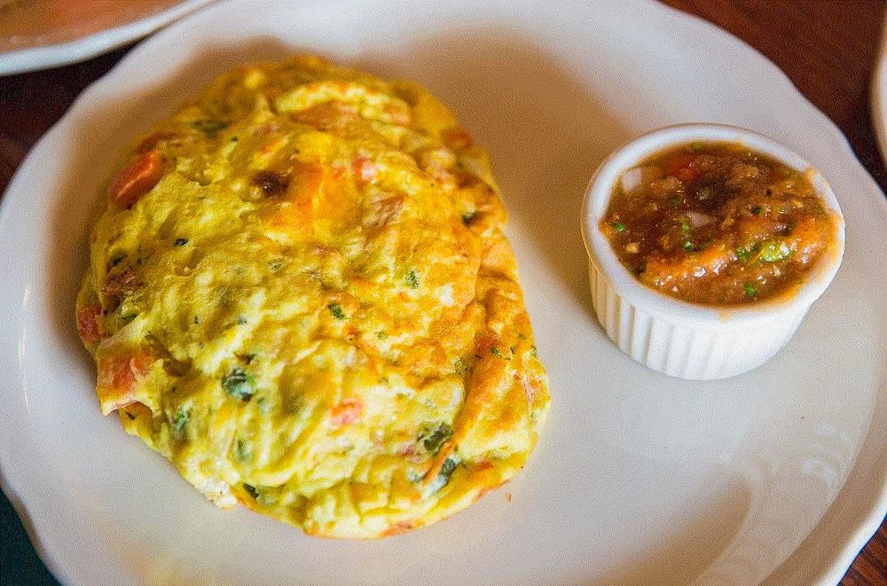 Santa Fe Omelette, Walker Bro's - Filled with fresh onions, cilantro, tomatoes, jalapeno peppers, and cheese, this Southwestern omelet will leave you content for the rest of your day. If you also want to spice it up a notch, try the salsa on the side for a kick.