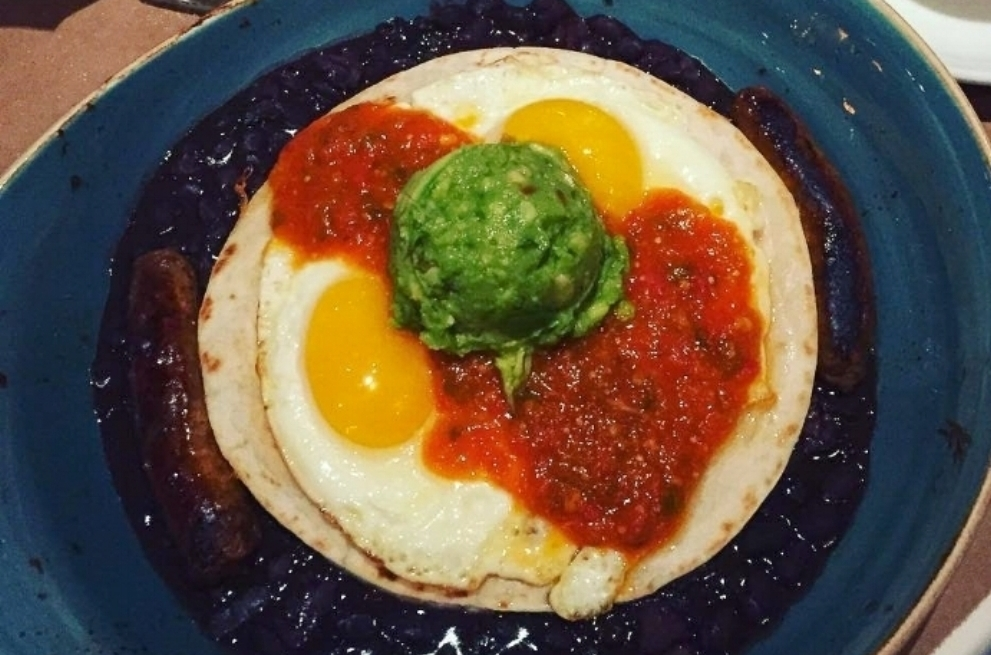Huevos Rancheros, The Cellar - If you can't make up your mind, why not get everything in one? With two fried eggs, Oxaca cheese quesadilla, chorizo, salsa, and frijoles charros, you'll without doubt get a bit of every flavor there is to taste.