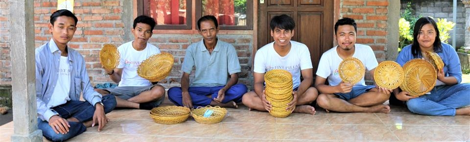 Some of the members of the Five Pillar Foundation team together with local community members, with 'Ingke' - traditional hand-woven baskets made from sticks of coconut.