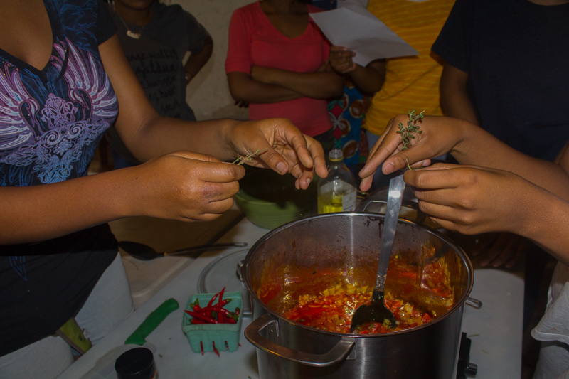 Little Sisters preparing West African Inspired Red Rice + Beans  Our Mothers' Kitchens 2018 Summer Workshop for Black Girls  Photo by Gabrielle Clark