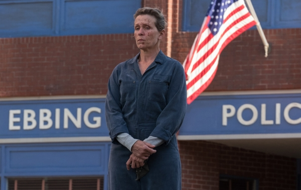 Institutional symbols and uniforms crossed with blood and real world significance: Frances McDormand as Mildred Hayes.