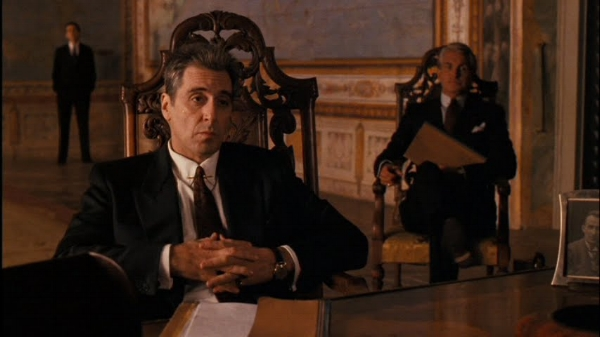 The meeting between Michael and Archbishop Gilday reverses the dynamics of the opening scene between Vito and Bonasera in the first film.