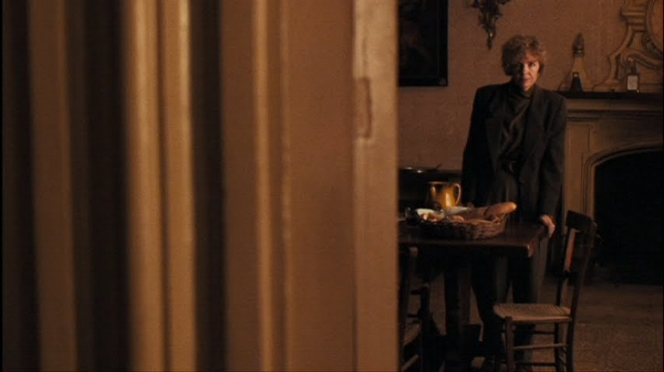 Familiar with this scenario, Kay (Diane Keaton) retreats from the doorway.