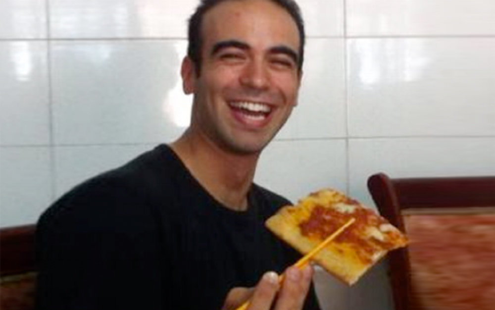 Alberto Maio eating pizza in China