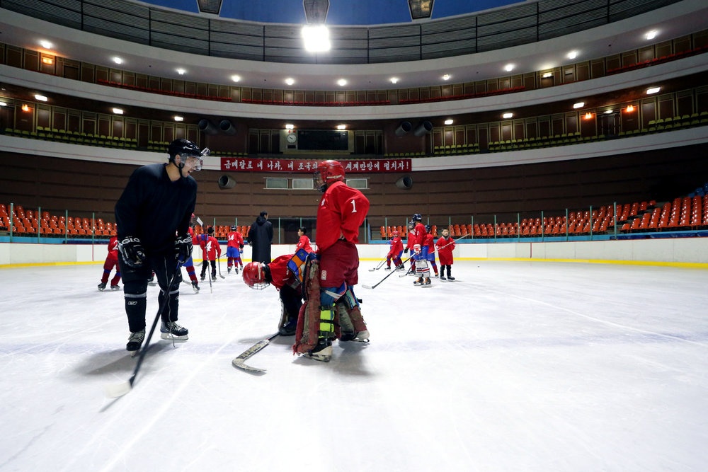 sunny-hahm-with-north-korean-youth-players-closing-the-gap-hockey-in-north-korea.jpg