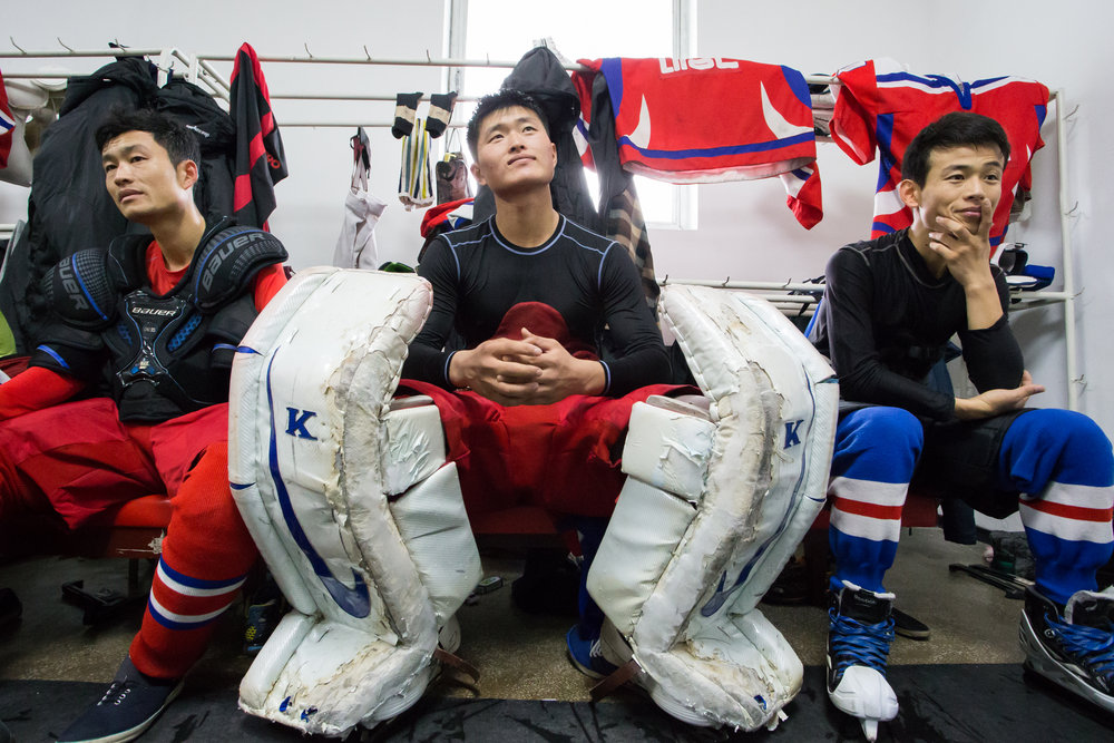 players-in-the-locker-room-closing-the-gap-hockey-in-north-korea.jpg