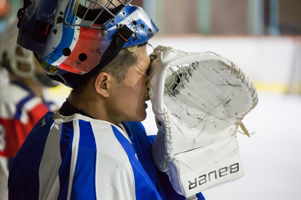 taesongsan-team-goalie-sipes-sweat-from-face-in-pyongyang-closing-the-gap-hockey-in-north-korea.jpg
