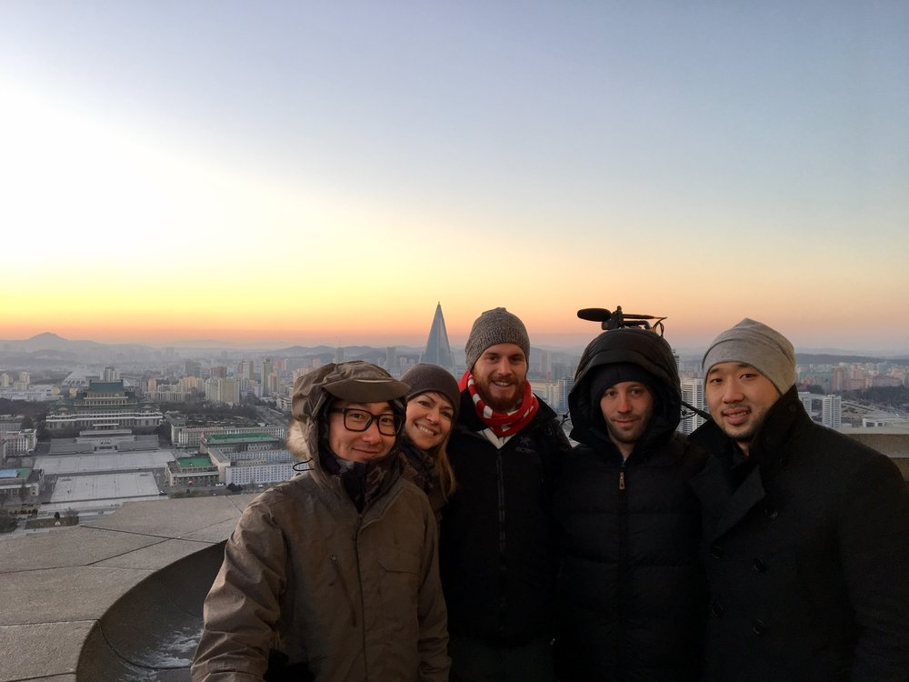 The crew filming a sunset timelapse on the top of the Juche Tower in Pyongyang.