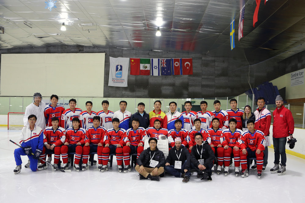 The crew poses for a photo with the entire DPRK Men's National Ice Hockey team in Auckland, New Zealand.