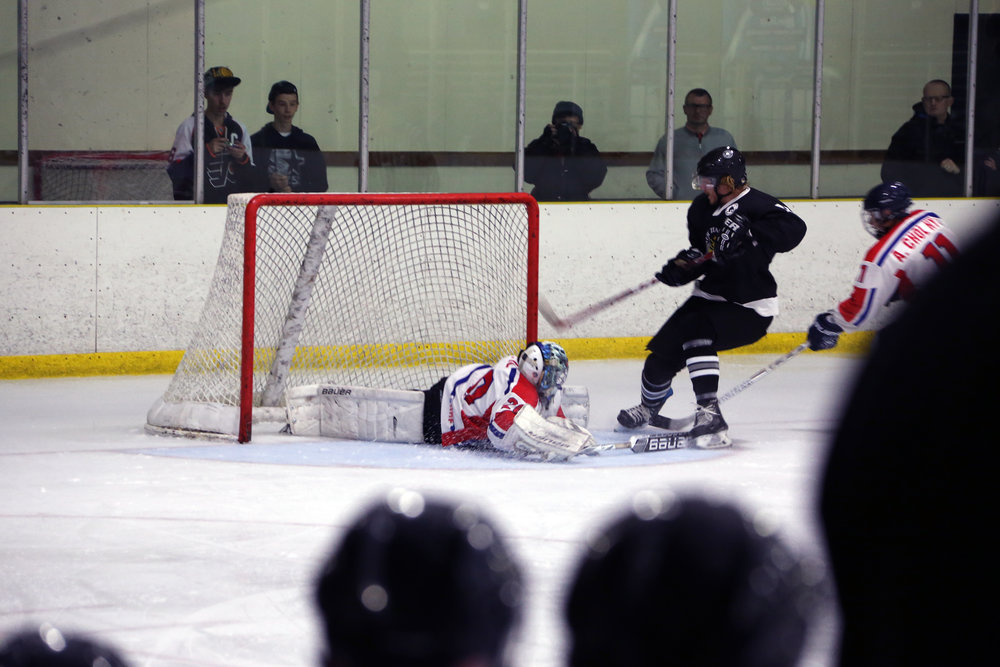 Backup Goalie Pak Il makes a crucial save during the game against Team New Zealand.
