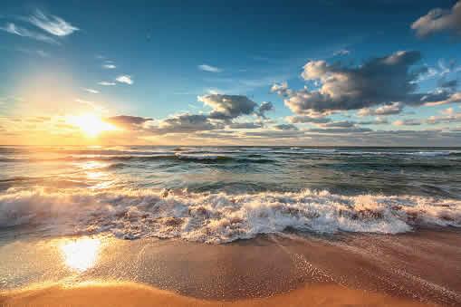 sunrise over seashore