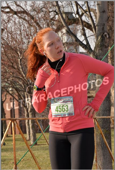 Here's a photo from the Santa Hustle half-marathon in December. Such an awkward picture!