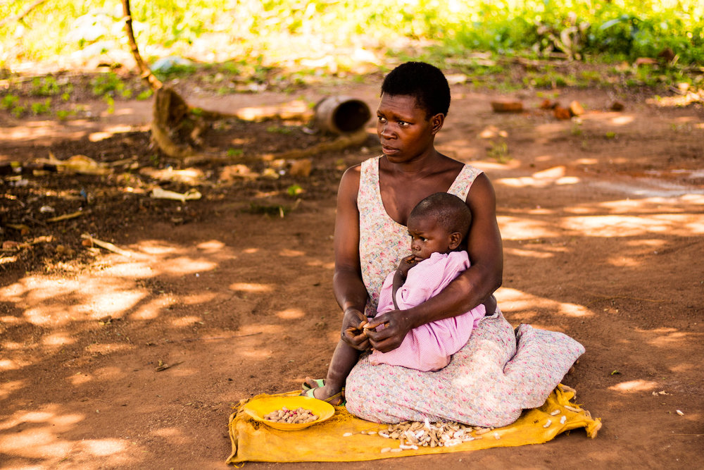 Women in the villages of Busoga often must supervise their babies and toddlers as they perform the domestic duties for which they are responsible.