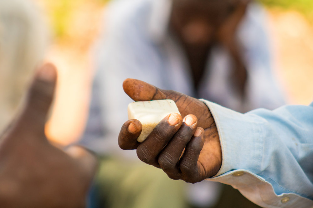It's not enough to tell a village that soap is important or even to hand out free soap. For a sanitation program to be sustainable, community members have to see and feel and smell why soap is worth the added expense of 250 shillings, or 7 cents, per week.