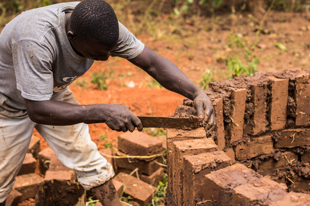 Some of the eight homes who still don't have a latrine have already dug their pit but are still building the structure around it. Structures are important for privacy and safety.