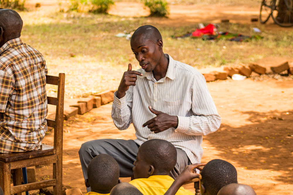 A teacher translated Manuela and Lorna's lesson into sign language to include the children with hearing impairment.