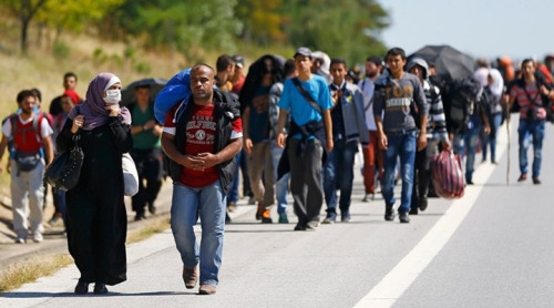 "Image from BGN News article ""Syrian refugees of Turkey on long 'walk of hope' to Europe."""