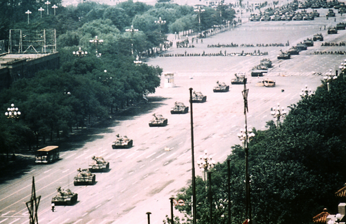 """Tank Man"" bringing a column of tanks near Tiananmen square to a halt."
