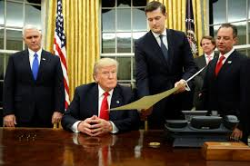 Image source . Rob Porter is holding the document     Link to the Wikipedia article on Rob Porter