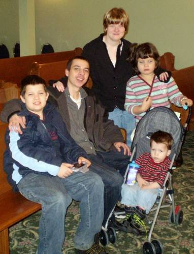 Me with my siblings my step brother is the only sibling with out 22q and the little one in the stroller he lived until he was 6 years old. The other two are alive and doing well like Bella and I are.