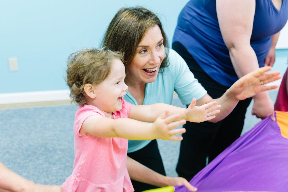 Kindermusik Teacher and girl with parachute.jpg