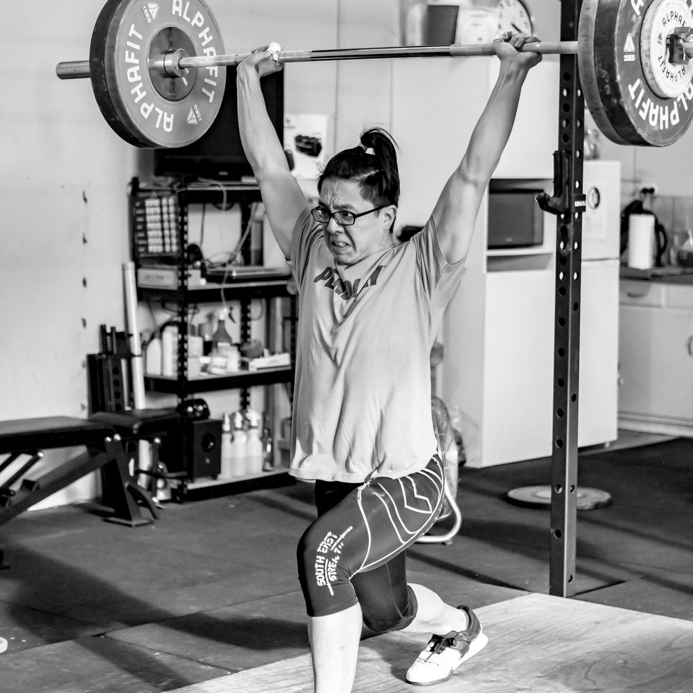 THE JERK - A single effort to move the barbell from the shoulders to an overhead position