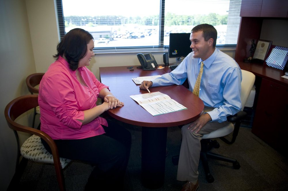Photo of a parent talking to a guidance counselor.