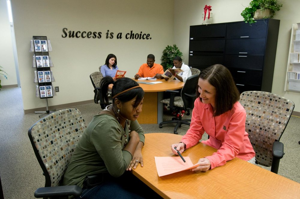 Photo of a student talking to a guidance counselor.