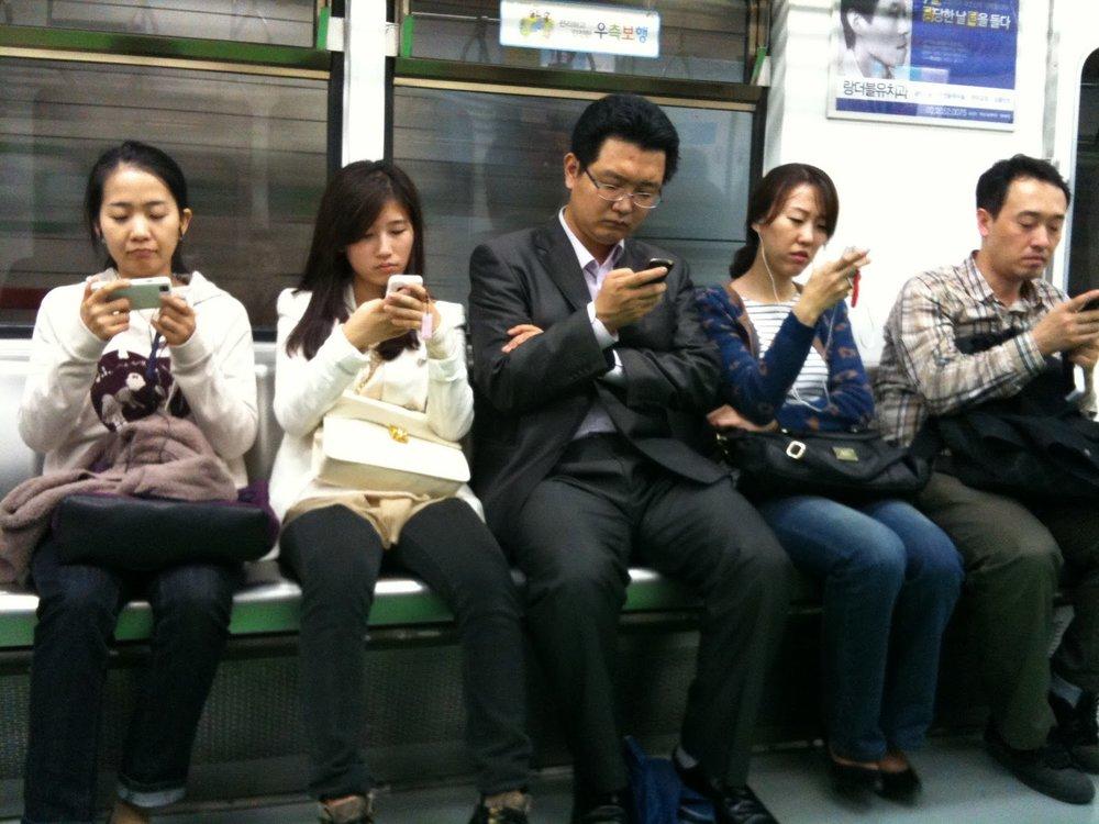 people on phones.JPG