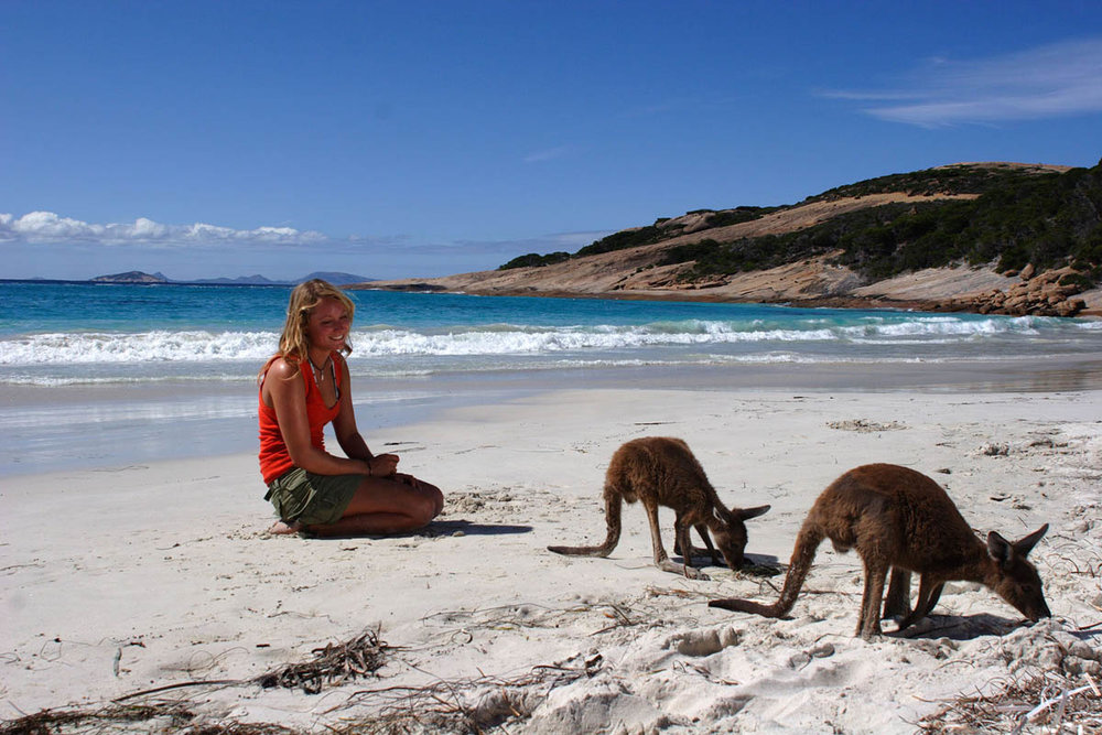 Girl with kangas lucky bay.jpg