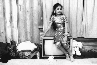 Cambodian Girl Sitting On A TV