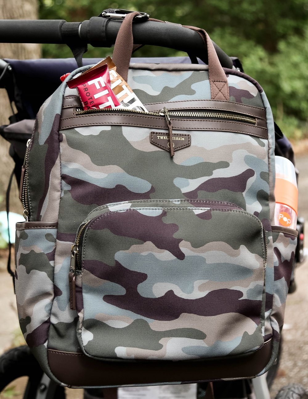 Twelve Little  Unisex Courage Backpack Camo Print says we're in this together as a family and travel as a team