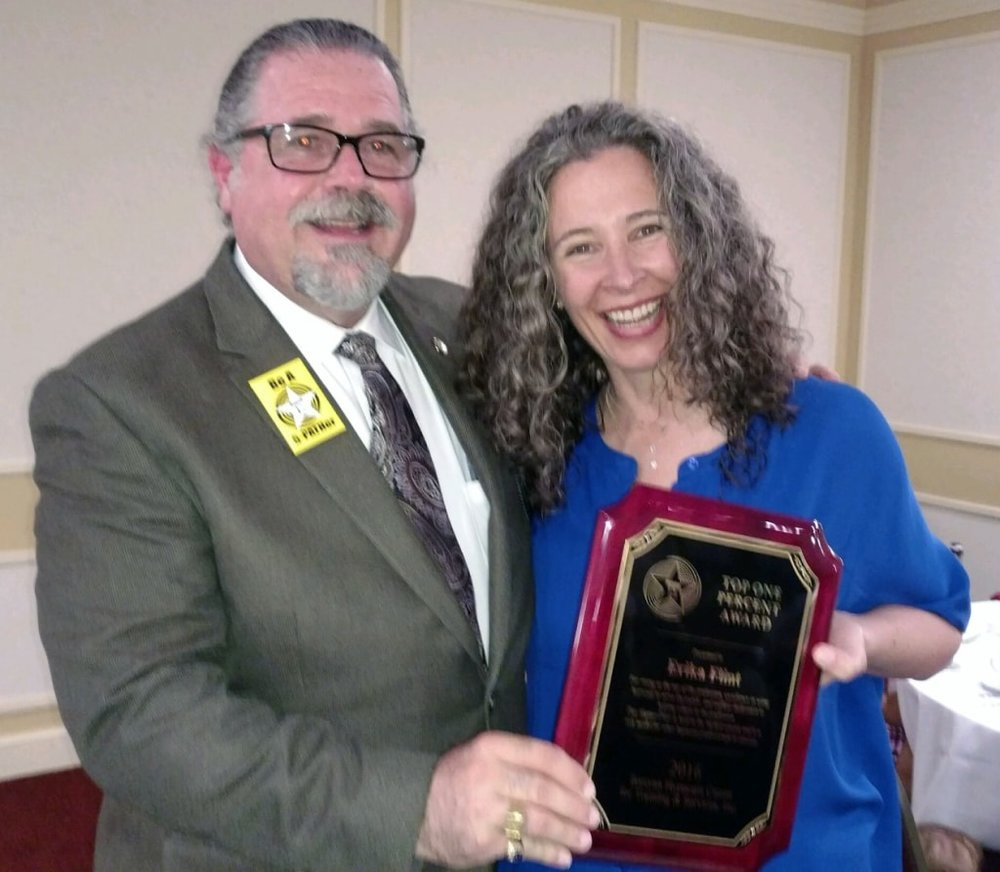 Erika Flint, President and Owner of Cascade Hypnosis Center and Board Certified Hypnotist and Certified Professional Hypnotherapy Instructor was awarded the 5-PATH ® 1%er Leadership award for 2016. Pictured here with Cal Banyan.