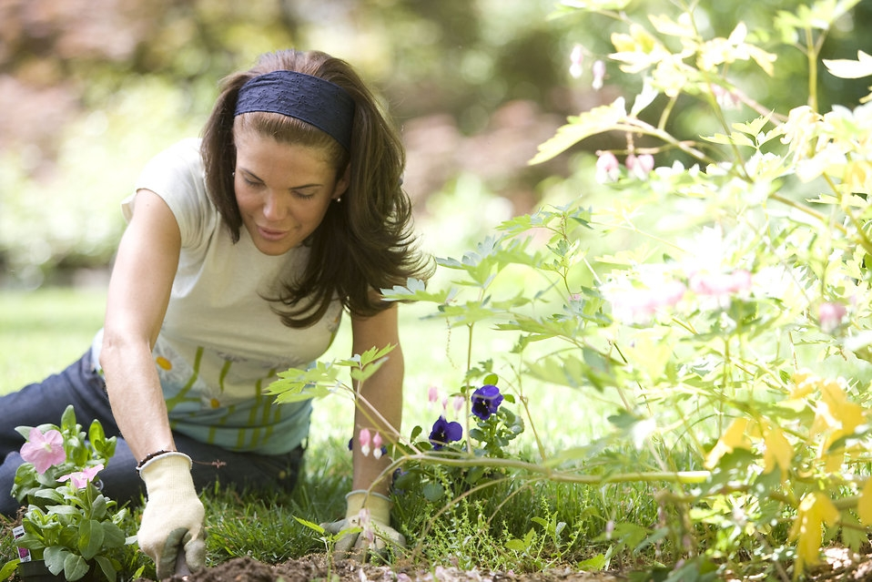 A Woman Enjoying Gardening Outdoors | Photo by  Dawn Arlotta