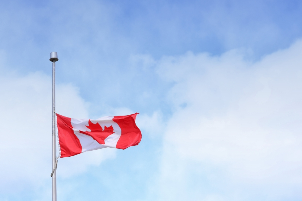 Canadian flag at half-mast | Photo by  Unsplash