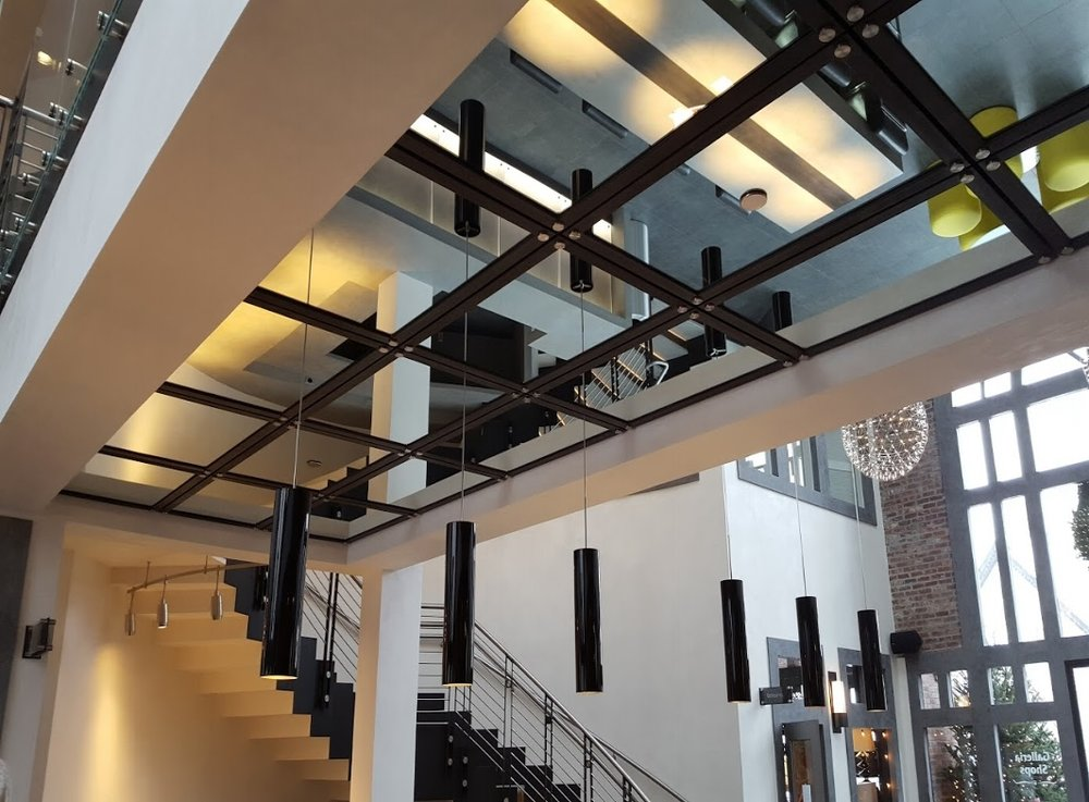 Galleria Building Custom Suspended Mirror System.