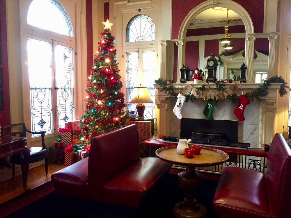 "Holiday decorations in the Colorado Governor's Mansion. This is a cozy space the designer did with train station style benches a la ""The Polar Express."" For story in  The Denver Post ."