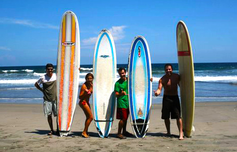 Surf-4 surfers on beach.jpg