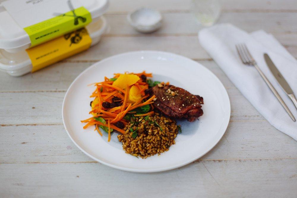 Moroccan spiced free-range chicken, carrot, orange, muscatel & mache salad, herbed wholegrain freekeh pilaf