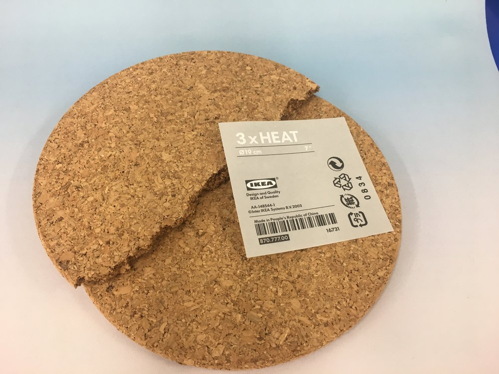A good cheap source for cork is Ikea. I like using cork that is about a half inch thick. That way you can model high or low.