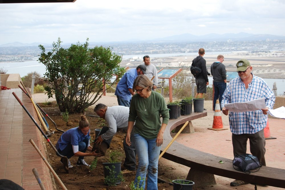 Greg Rubin (R) and volunteers replanting the border next to east side of the Visitor Center with a glorious view of downtown San Diego to the east.