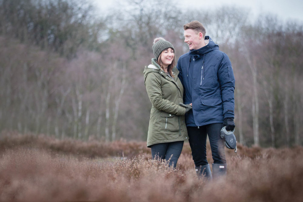 """Despite only being a few miles from where I live in Wetherby, when Scott and Katy suggested meeting at Bardsey Beck for their pre-wedding shoot, I admit that I had to get the OS map out to find out where it was! It turns out to be a bit of a hidden gem. Expecting there to be just a little steam running through some woods, I was pleasantly surprised to find that it is home to Hetchell Wood Nature Reserve which includes a 10 metre high cliff (great for photographs!) and the Pompocali earthworks, believed to be of Roman origin (well, with a name like """"Pompocali""""…)  Scott and Katy were so natural in front of the camera. Despite being a little nervous to start with, they clearly love being in each others company, and I think that comes through in the photographs by how much they made each other laugh. I know that I am going to have a very easy job when I photograph them again on their wedding day at  The Normans  in April…."""