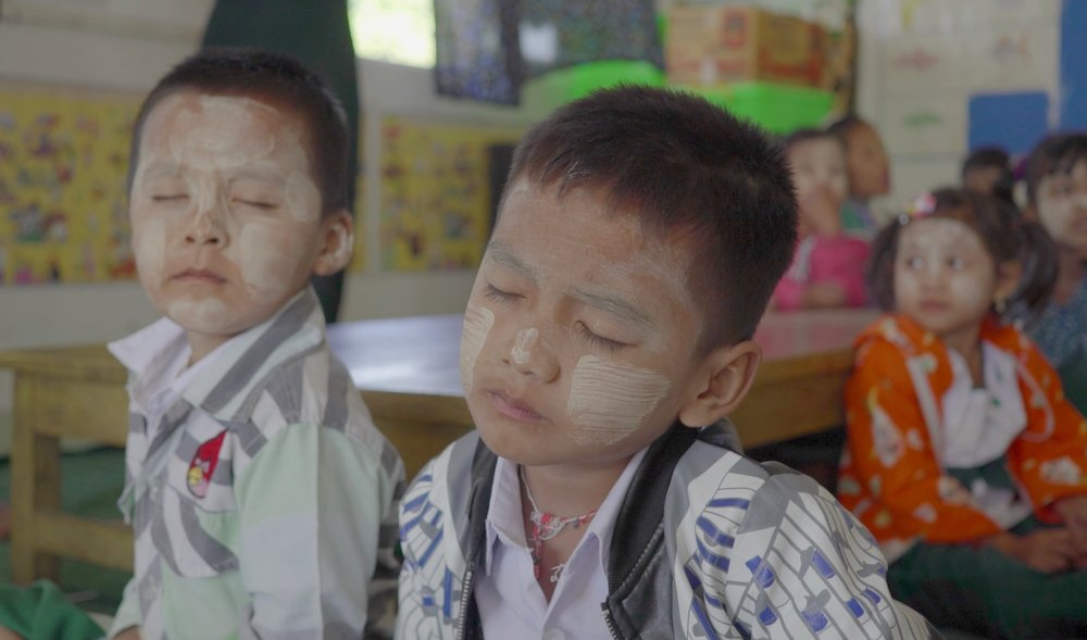 Burmese children wearing Thanaka at a Buddhist monastery school in Myawaddy. The monastery schools are set up for children who are unable to afford the school uniforms or supplies necessary for the state run schools.