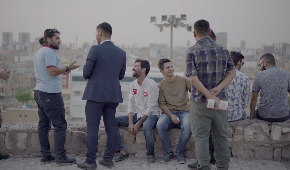 Honer and his friends chat in the citadel overlooking Erbil.