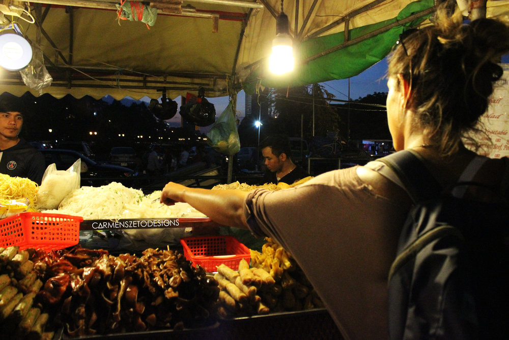 Night food market in Phnom Penh, Cambodia highlighting the cow intestine, spring rolls and noodles we ate!