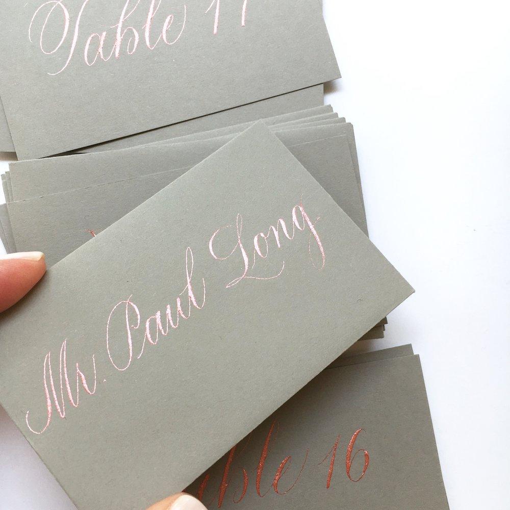 rosegold on grey escort cards.JPG
