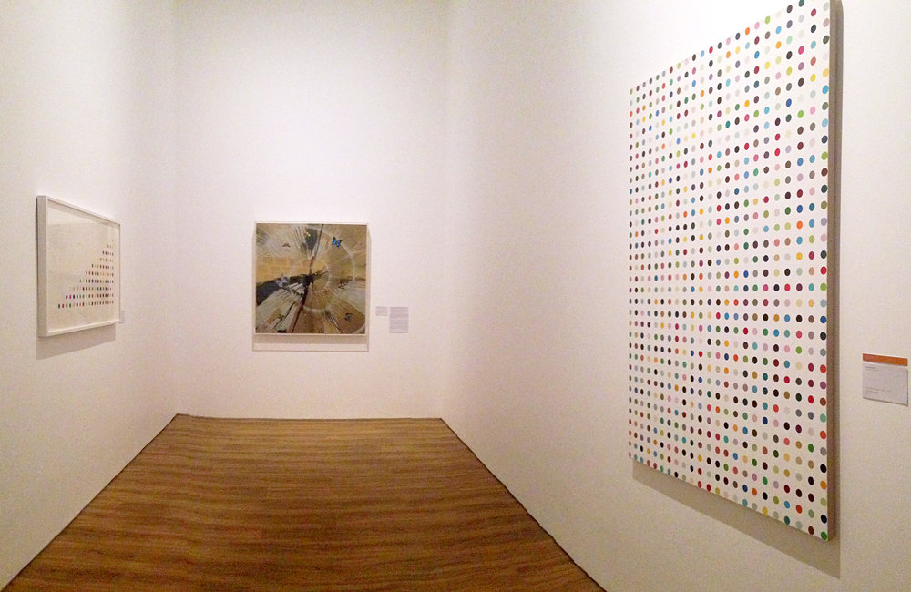 From left to right:  Pendhimetrazine  (2011),  Beautiful Magnificent Heaven Never Fails to Surprise painting (with Butterflies and Diamonds)  (2007),  Phenylbenzaldehyde  (2008-2011); all by Damien Hirst