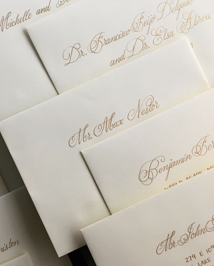 cream and gold wedding envelopes